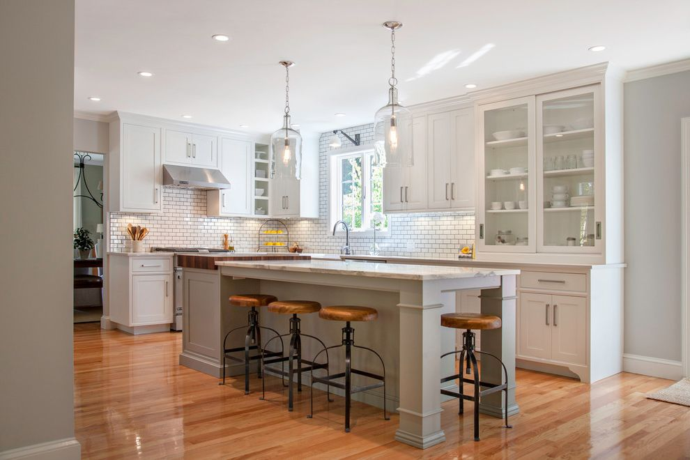 Satin Nickel Light Fixtures   Farmhouse Kitchen  and Dark Grout Glass Bell Jar Pendant Lights Island Lighting Kitchen Island Kitchen Window Light Gray Walls Medium Wood Floor Range Hood Recessed Lighting Swivel Bar Stools White Kitchen Cabinets