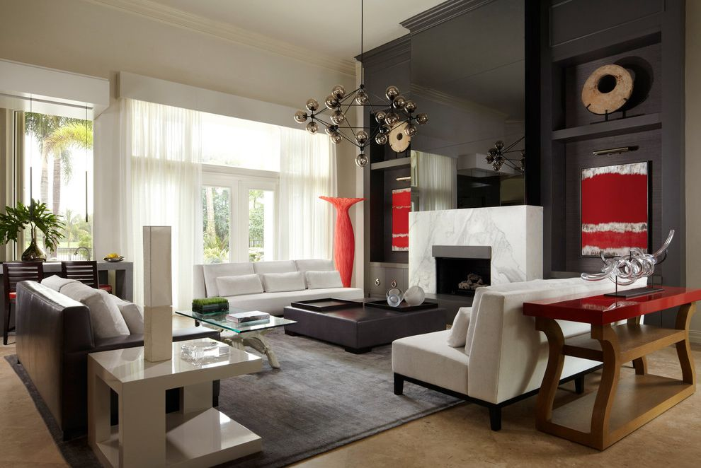 Saunders Furniture   Contemporary Living Room Also Abstract Artwork Chandelier Console Table Dark Stained Wood Desk Gray Area Rug Great Room High Gloss Large Seating Area Marble Fireplace Surround Red Red Accents Sheer Curtains Transitional White Sofa