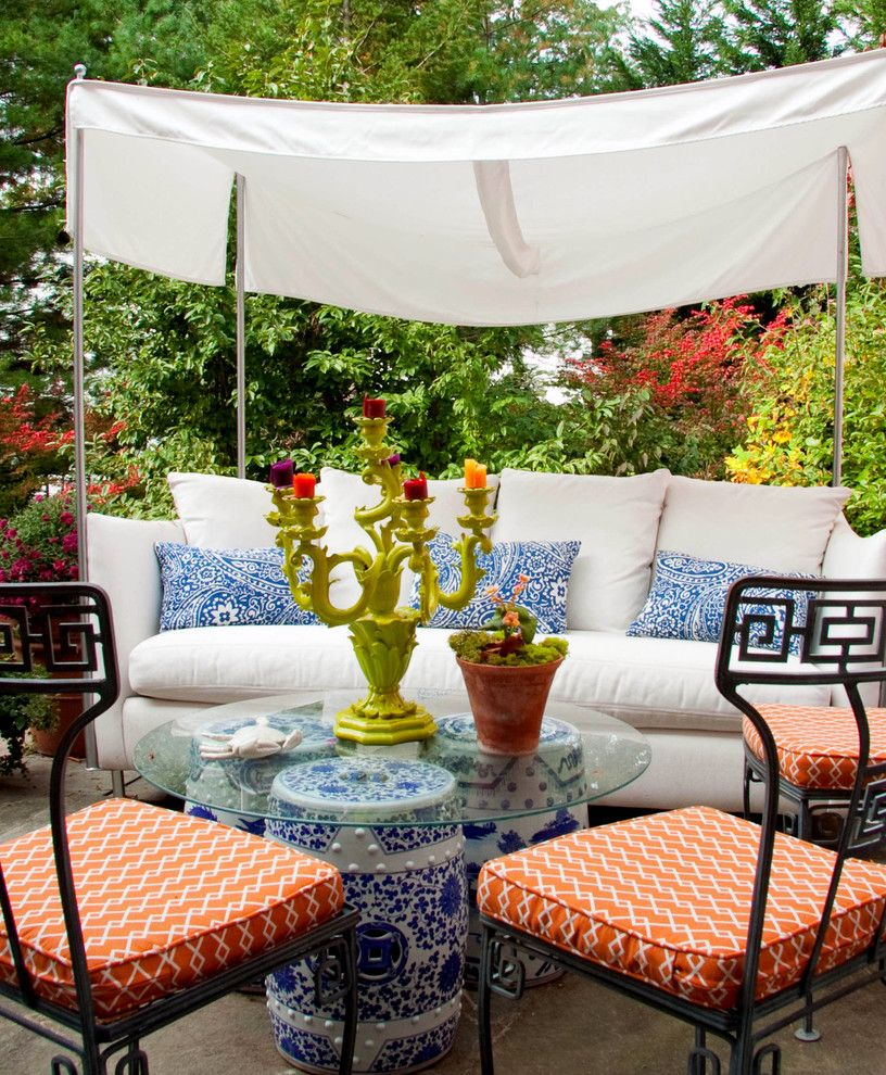 Saunders Furniture with Contemporary Patio  and Awning Blue Candelabra Ceramic Stools Garden Furniture Glass Top Table Metal Outdoor Furniture Orange Outdoor Seating Patio Printed Cushions Sun Shade