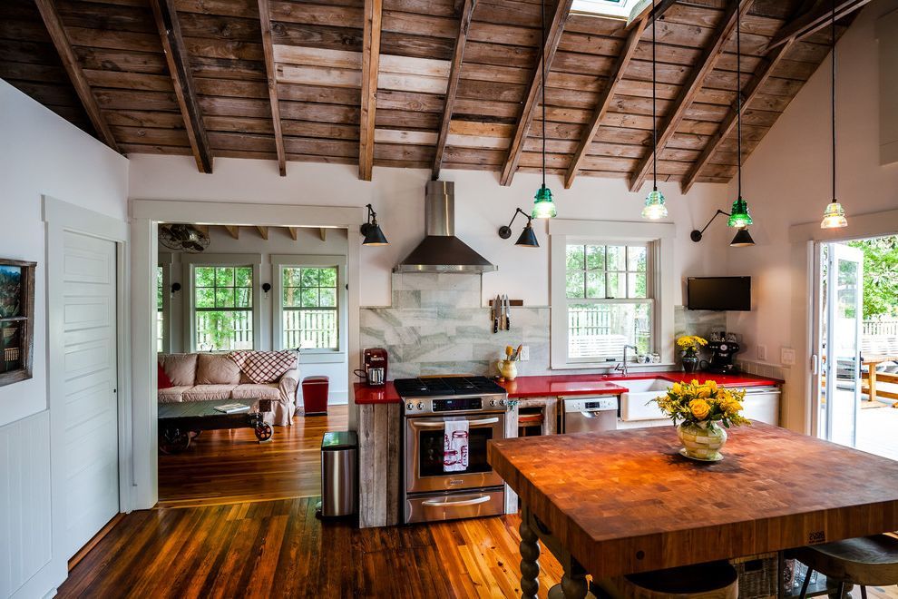 Savoy Pittsburgh with Farmhouse Kitchen  and Butchers Block Dark Wood Exposed Beams Kitchen Island Pendant Lights Red Countertop Red Countertops Sky Light Vaulted Ceiling Wood Ceiling