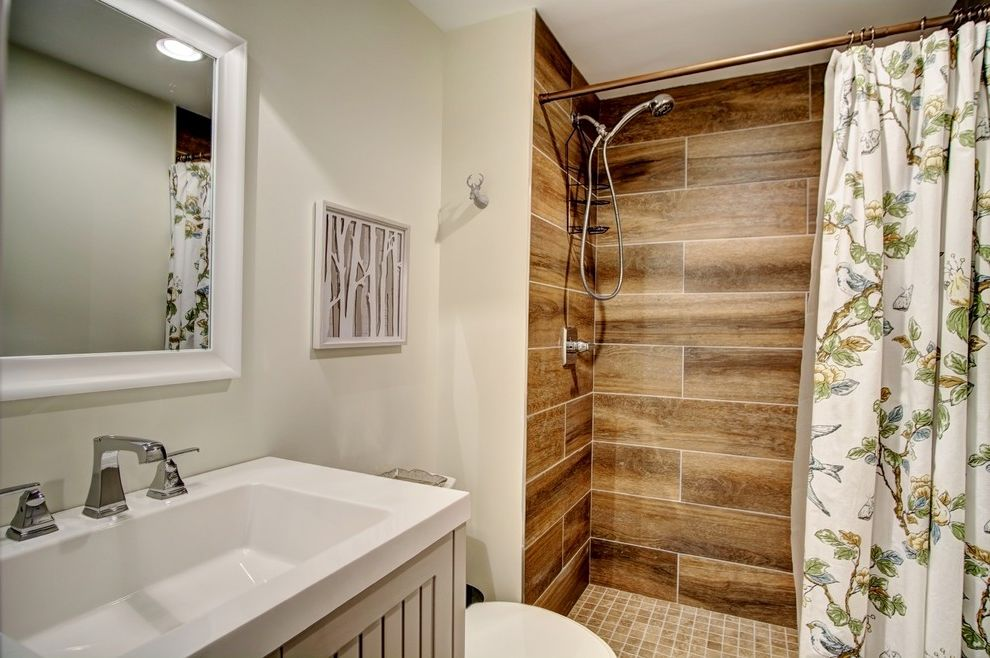 Schuster Homes with Rustic Bathroom  and Contemporary Rustic Floral Shower Curtains Gray Bathroom Gray Cabinets Gray Walls Mountain Home Shower Curtains Single Vanity Taupe Walls Wall Art Wood Paneling Wood Siding
