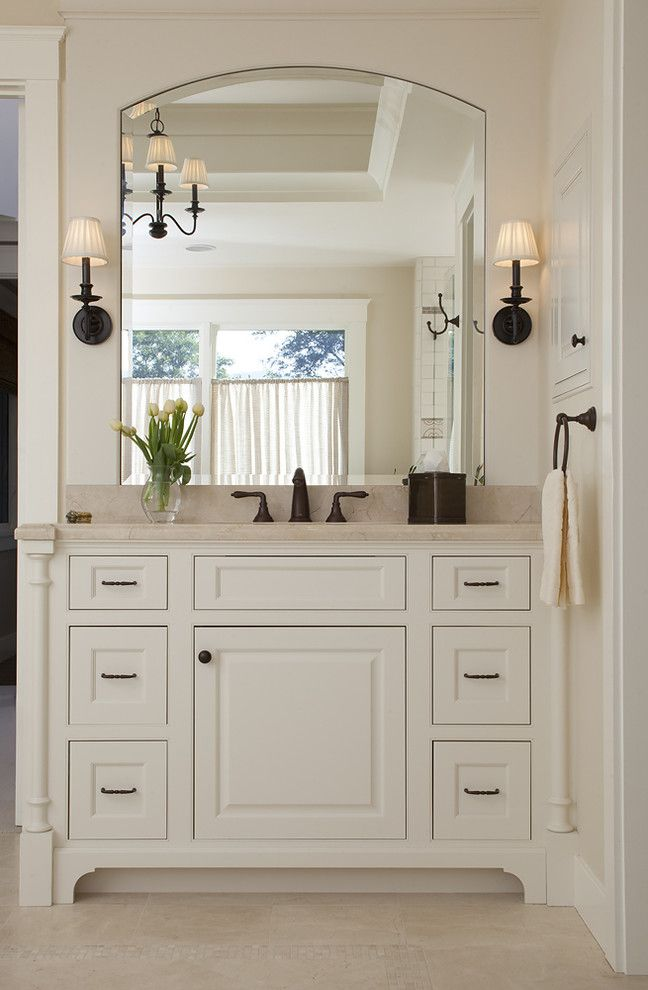 Sconces Definition with Traditional Bathroom  and Baseboards Bathroom Lighting Chandelier Crown Molding Footed Cabinets Neutral Colors Sconce Wall Lighting White Bathroom White Cabinets White Wood Wood Cabinets Wood Molding