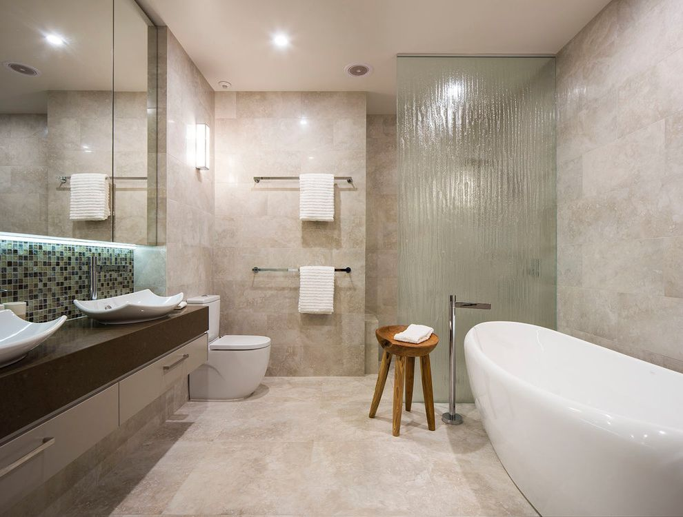 Scotch Glass Name with Contemporary Bathroom and Double Sinks Frosted Glass Recessed Lighting Tile Floor Towel Bars Wall Mirror Wall Sconce Wood Stool