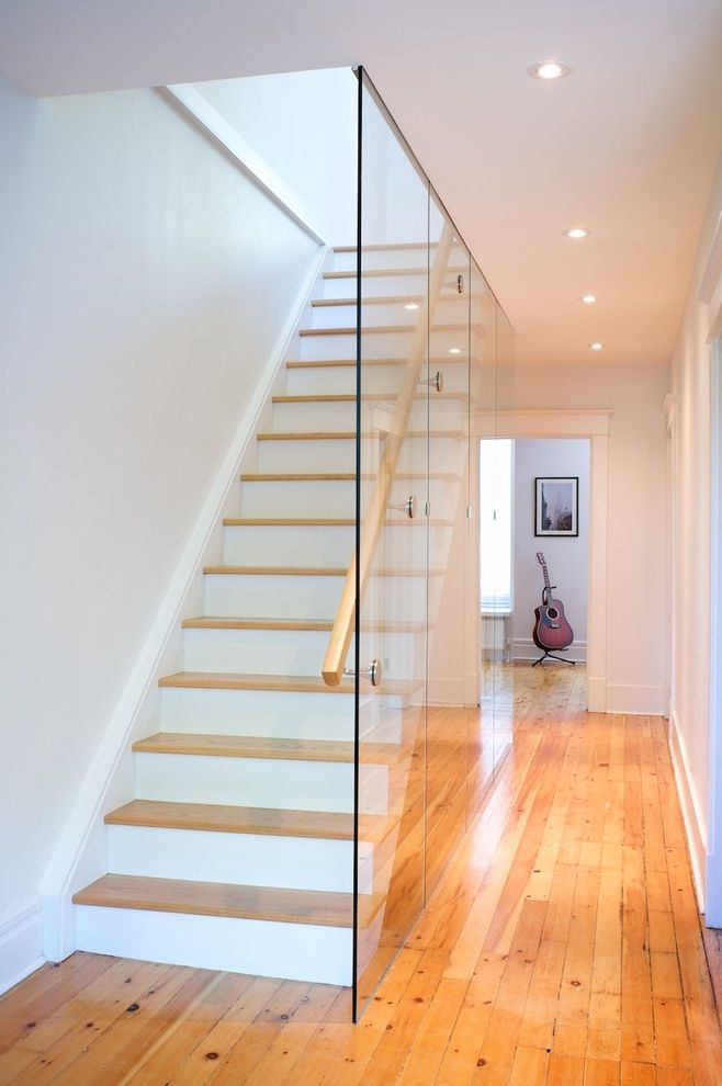 Scotch Glass Name with Modern Staircase and Glass Wall Light Wood Floor Recessed Lighting Staircase Railing White Trim White Walls Wood Staircase