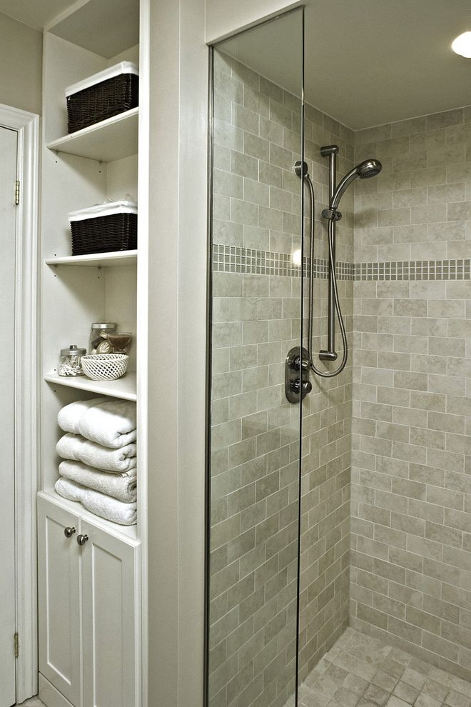 Scotch Glass Name with Traditional Bathroom and Bathroom Storage Glass Accent Tiles Glass Shower Door Neutral Colors Storage Baskets Subway Tiles Tile Flooring Tile Wall Towel Storage White Wood Wood Trim