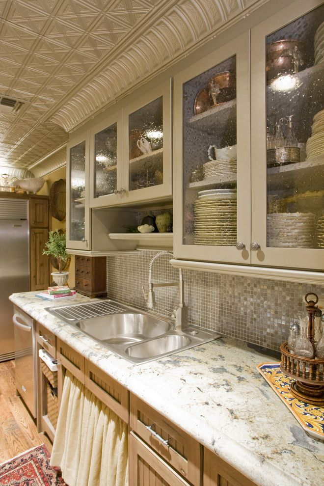 Scotch Glass Name with Traditional Kitchen and Glass Mosaic Tile Backsplash Seeded Glass Door Fronts Skirted Sink Cabinet Stainless Steel Sink Textured Glass Tin Ceiling Tiles Tin Crown Molding Tin Crown Moulding White Granite Counter