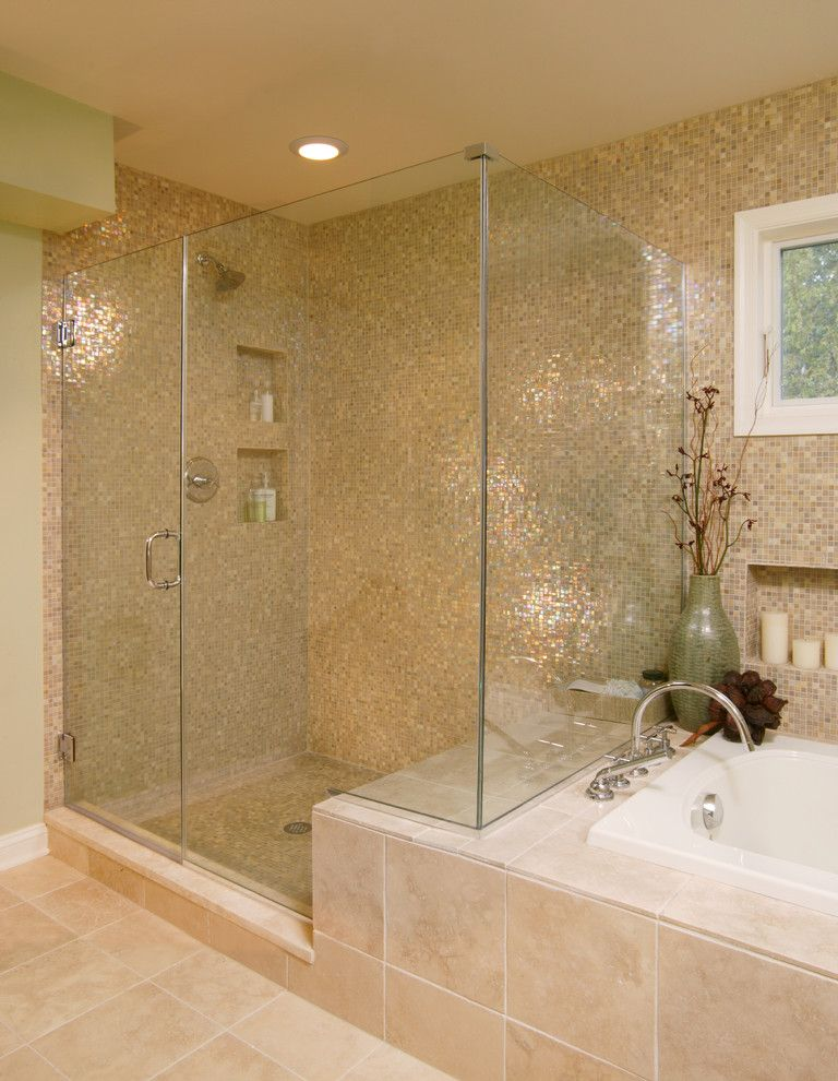 Scotch Glass Name with Transitional Bathroom and Bath Fixtures Candles Ceiling Lighting Frameless Shower Glass Shower Glass Tile Mosaic Tile Neutral Colors Shower Bench Tile Flooring Tub Surround Vase Wall Tile