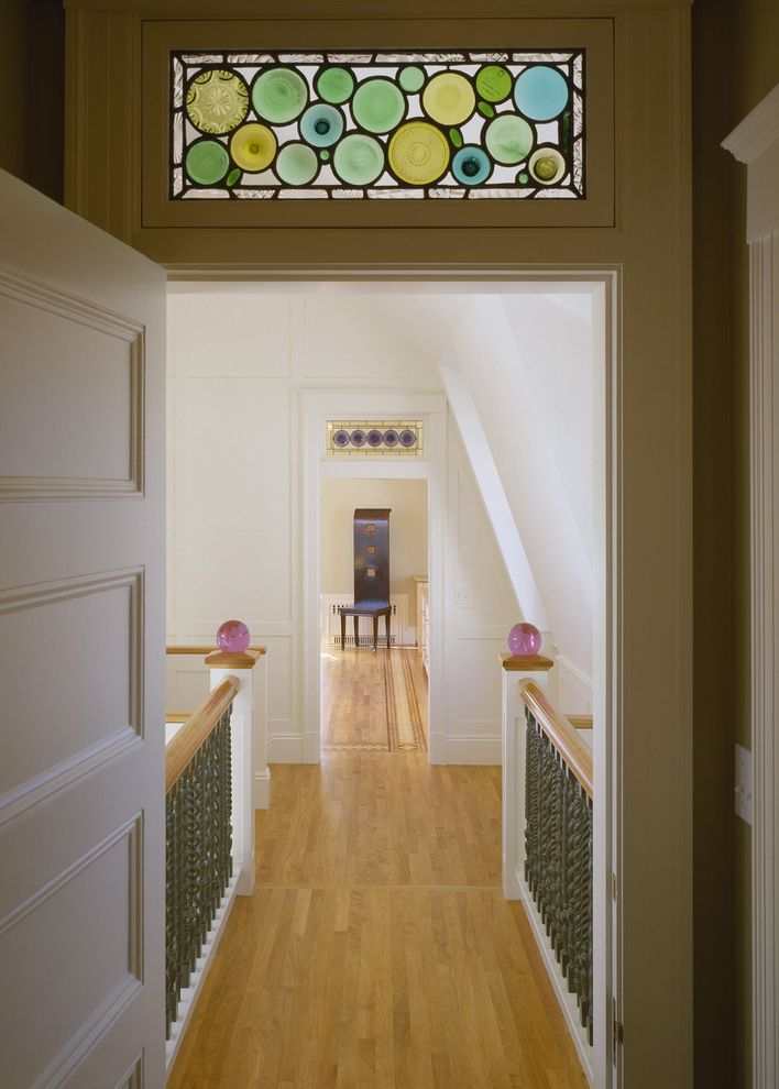 Scotch Glass Name with Victorian Hall and Glass Finials Iron Railing Stained Glass Transom White Painted Wood White Walls Wood Floor
