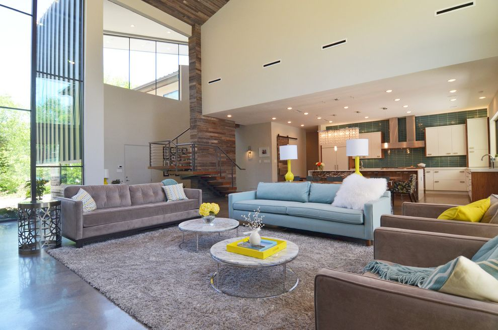 Scott Miller Salon   Contemporary Living Room  and Blue and Yellow Circular Table Coffee Table Lamps Modern New Leaf Open Concept Shag Rug Sofa Vaulted Ceilings Windows Wood