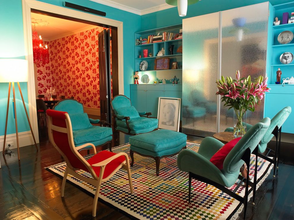 Scott Miller Salon with Eclectic Living Room Also Blue Walls Built in Cabinets Crown Molding Dark Stained Wood Floor Mirrored Armoire Mosaic Rug Pendant Red Seating Area Tripod Lamp Turquoise Wallpaper White Baseboard White Trim