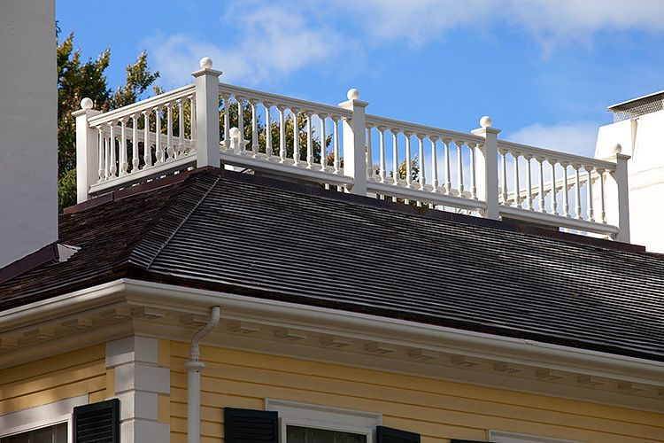 Sea Captains House with Traditional Exterior Also Ball Finials Balusters Balustrade Composite White Trim Widows Walk