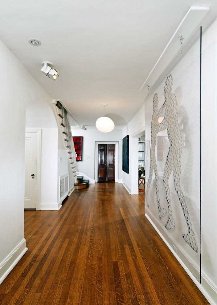 Sea Glass Art Ideas with Contemporary Hall Also Baseboards Ceiling Lighting Gallery Wall Glass Wall Globe Light Minimal Pendant Lighting Wall Art Wall Decor White Room Wood Doors Wood Flooring