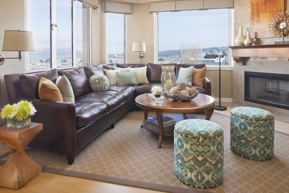 Sectional Couches on Sale   Traditional Family Room Also Accent Tables Area Rug Brown Leather Couch Coffee Table Fireplace Mantle Nail Head Detail Ottomans Pillows Sectional Stools Valance View Wall Sconce Wood Floor