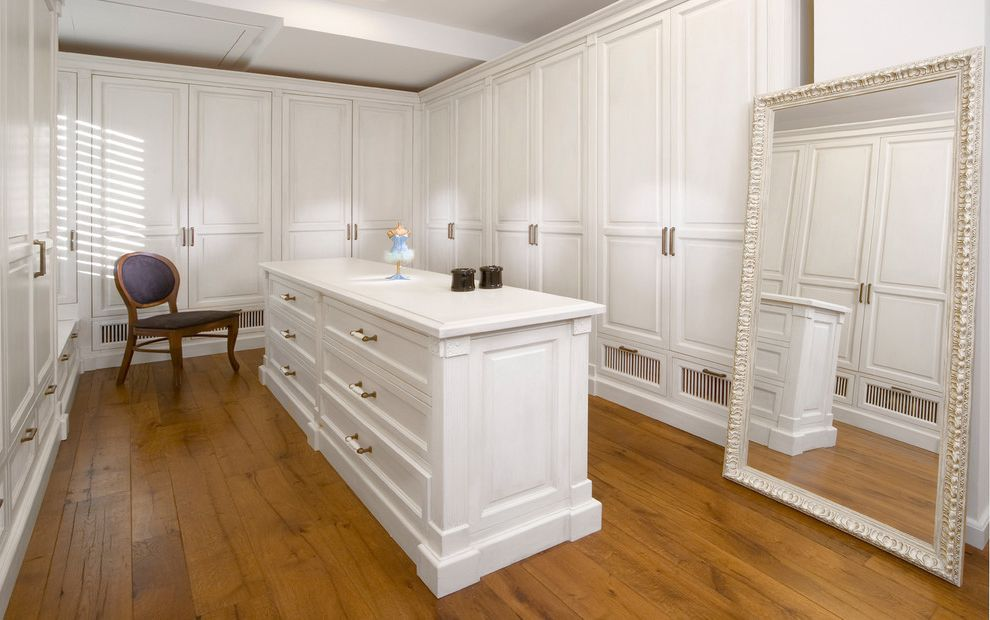 Serenity Rejuvenation Center   Contemporary Closet Also Armoire Built Ins Door Handles Drawer Pulls Dressing Room Framed Mirror Island Leaning Mirror Monochromatic Oversized Mirror Walk in Closet Wardrobe White Cabinets Wood Cabinets Wood Flooring