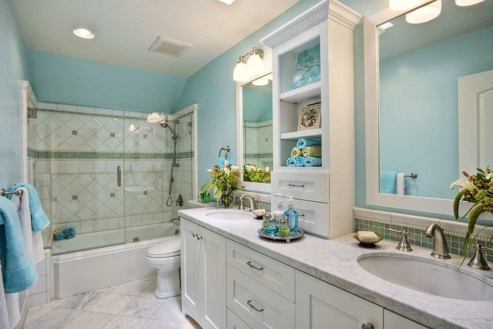 Serenity Rejuvenation Center with Traditional Bathroom Also Accent Tile Band Diamond Tile Pattern Double Sink Vanity Framed Mirror Frameless Shower Glass Green Mosaic Tile Two Sinks Wall Sconce White Countertop White Floor Tile