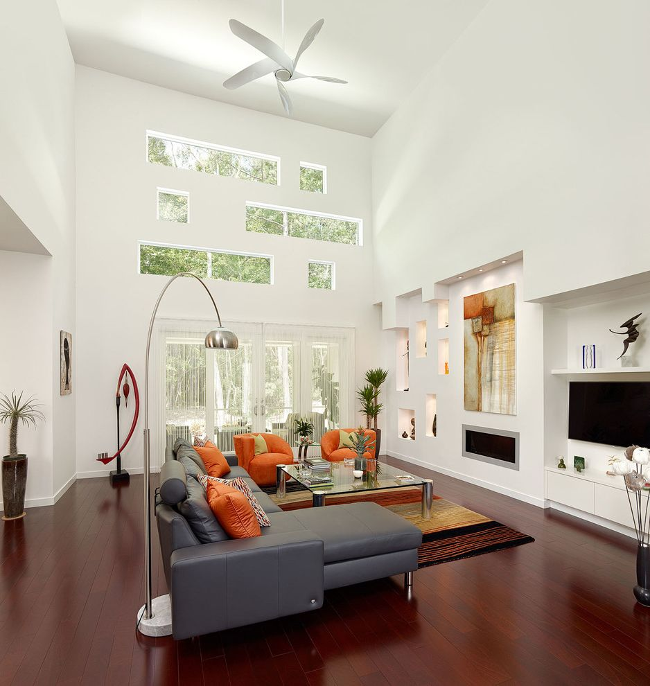 Servpro Charleston Sc   Contemporary Living Room  and Arc Lamp Art Lighting Ceiling Fan Contemporary Artwork Leather Sofa Modern Decor Niche Orange Chairs Rug Tall Ceilings Windows