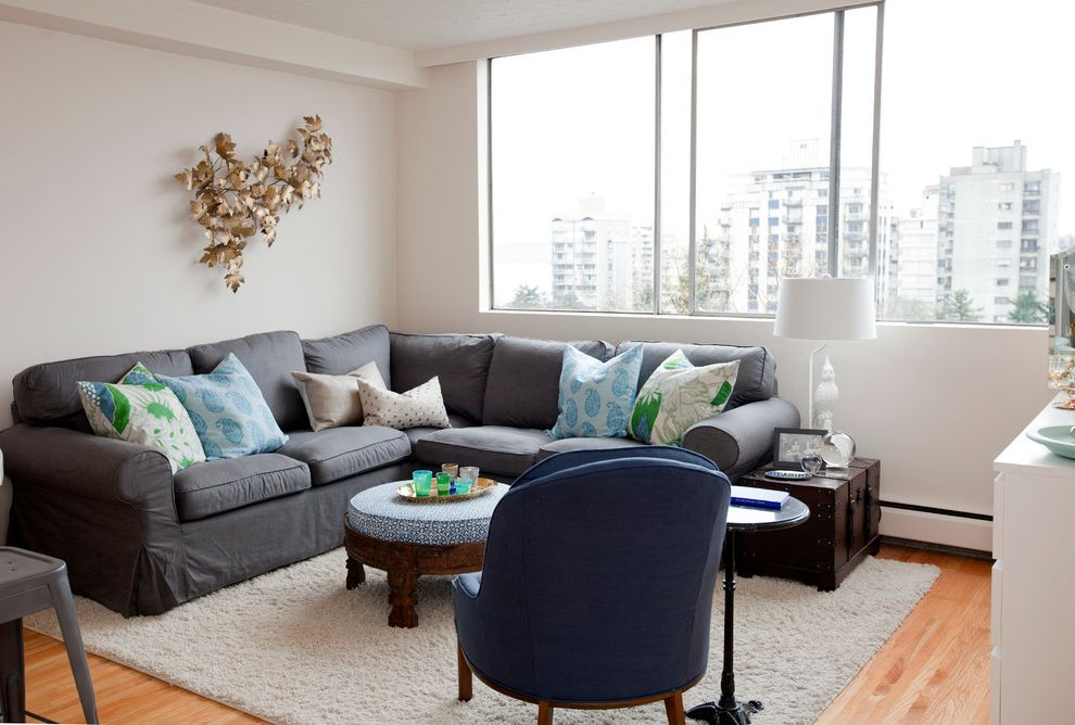 Shag Rugs Ikea   Eclectic Living Room  and Blue and Green Branch Art Gray Sectional Sofa Light Gray Rug Medium Wood Floor Round Ottoman Shag Rug Sliding Windows White Lampshade White Table Lamp White Walls