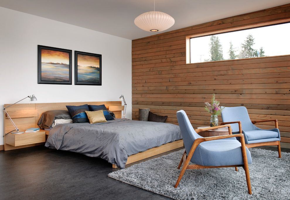 Shag Rugs Ikea with Industrial Bedroom Also Area Rug Artwork Blue Built in Nightstands Concrete Floor Gray Pendant Light Platform Bed Reading Light Seating Area Task Light Tongue and Groove Wood Paneling