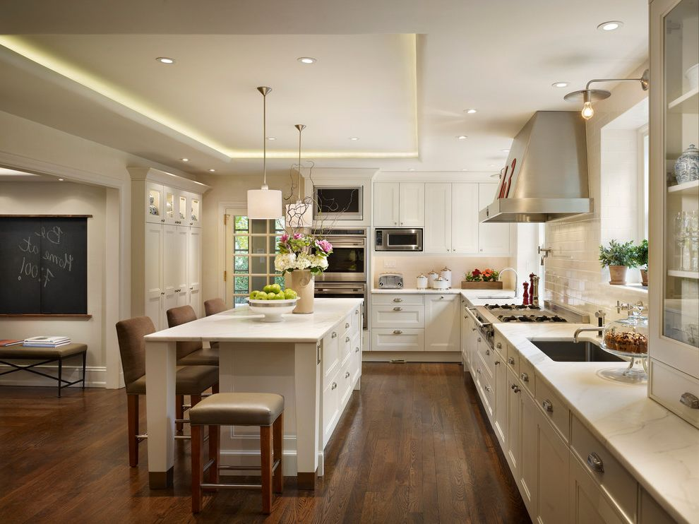 Shallow Depth Cabinets with Traditional Kitchen Also Chalkboard Cove Lighting Dark Wood Flooring Hardwood Flooring Kitchen Island Oak Floor Pendant Lights Tray Ceiling Upholstered Bar Stools White Kitchen