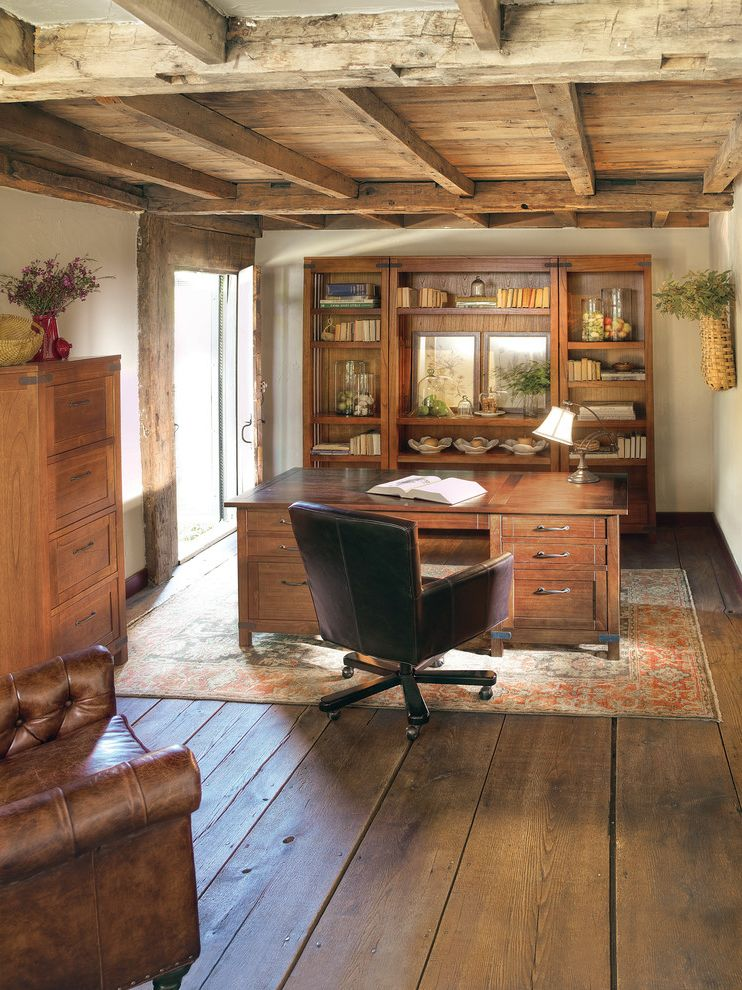 Shamrock Plank Flooring with Traditional Home Office Also Book Shelves Brown Leather Chair Natural Lighting Office Chair Red Persian Rug Rustic Wood Wide Plank Flooring Wood Beams Wood Ceiling Wood Desk Wood Dresser Wood Flooring