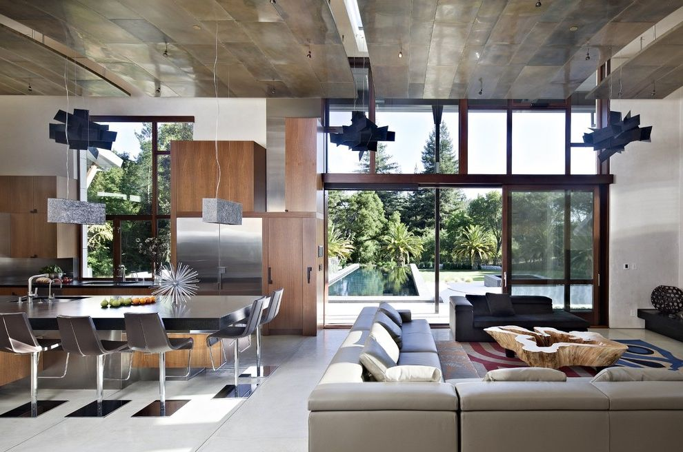 Sheet Metal Homes   Contemporary Living Room  and Custom Wood Cabinets Gray Leather Sectional Lofted Ceiling Polished Concrete Floors Stainless Appliances Suspension Lights Swivel Counter Stools