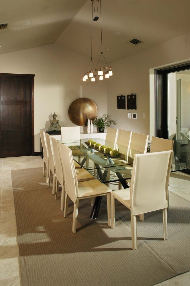 Sherwin Williams Omaha   Contemporary Dining Room  and Area Rug Buddha Chandelier Cream Dark Wood Door Dave Adams Photography Dining Area Dining Chair Glass Table Ivory Open Plan Saw Horse Table Suspended Lighting Taupe Tile Floor