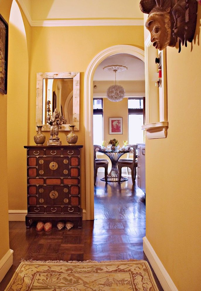 Sherwin Williams Portland   Eclectic Entry  and Arch Baseboard Ceiling Lighting Console Table Crown Molding Entry Table Foyer Hallway Parquet Flooring Pendant Lighting Runner Rug Vase Wall Decor Wall Mirror Wood Flooring Yellow Wall
