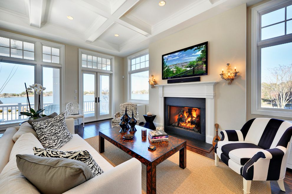 Sherwin Williams Portland   Traditional Living Room  and Animal Print Bergre Chair Coffered Ceiling Fireplace Glass Doors Ivory Lake View Mantel Off White Orchid Oyster Shell Sconce Parsons Coffee Table Transom Tv Over Fireplace Urns Water View Zebra