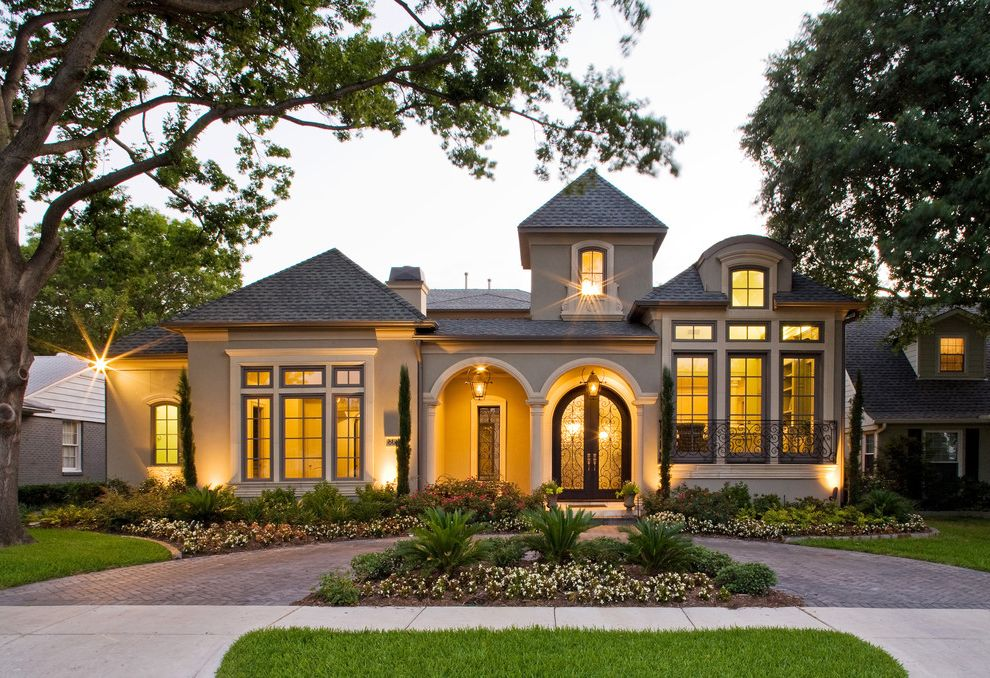 Sherwinn Williams   Mediterranean Exterior  and Arched Doorways Brick Chimney Circular Drive Covered Entry Dormer Double Doors Drivway Entry Front Yard Landscaping Lanterns Pavers Tall Windows Tower