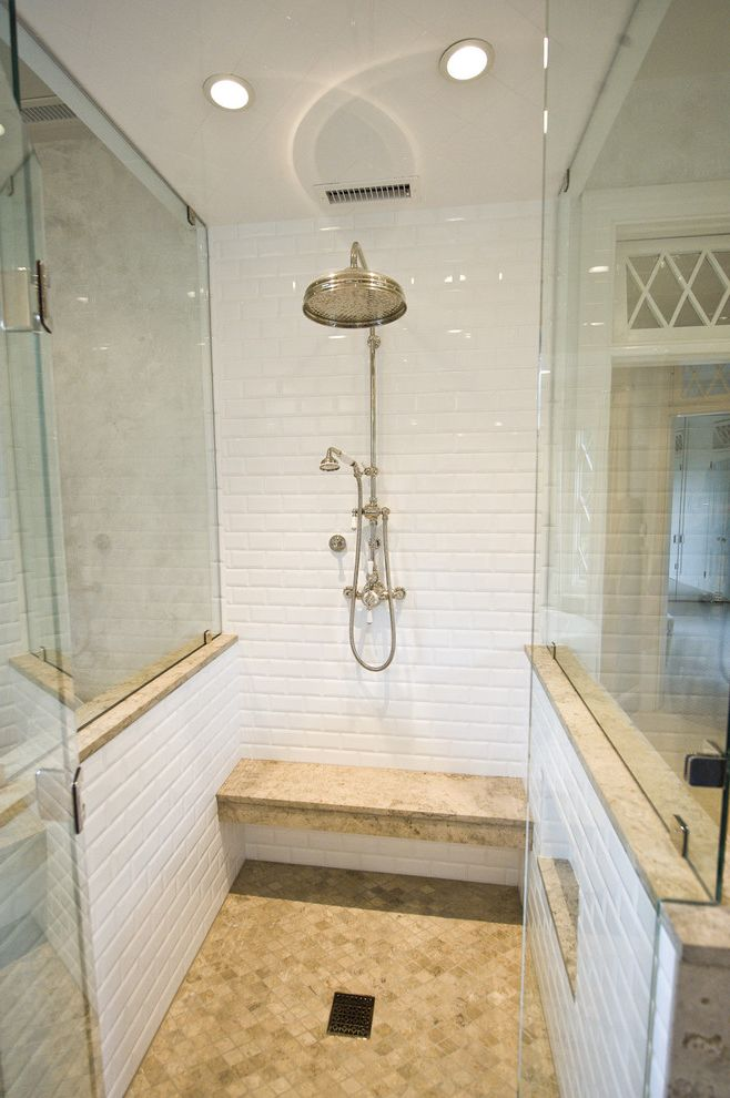 Shower Benches for Disabled with Traditional Bathroom  and Bench Seat Built in Custom Woodwork Glass Shower Enclosure Gray Marble Mirrors Rain Shower Recessed Lights Shower Bench Subway Tile Tile Floor Transom Window