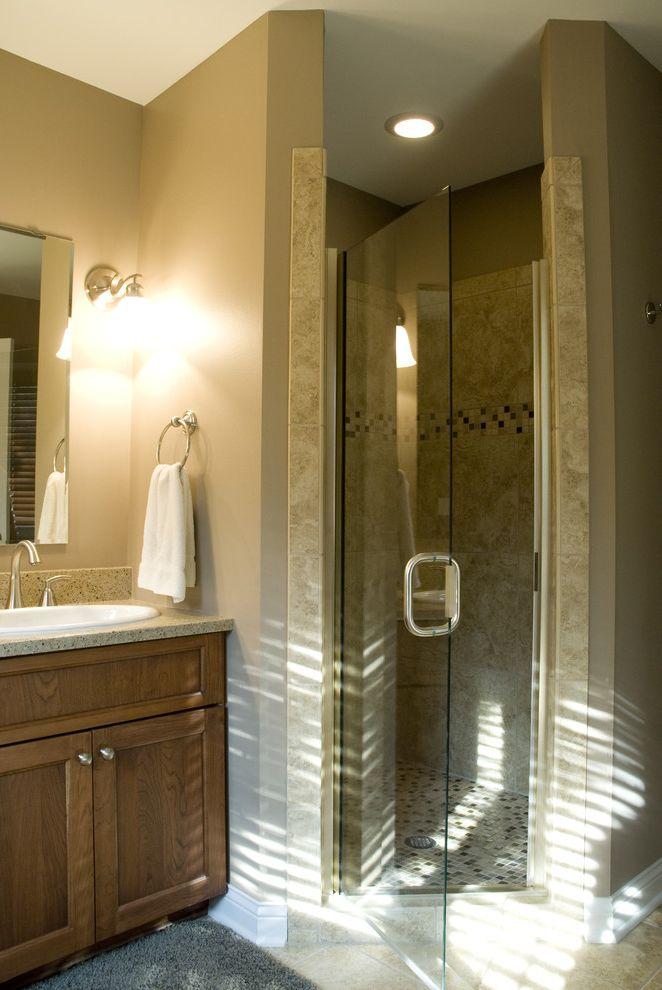 Shower Door Weather Strip   Traditional Bathroom Also Glass Shower Door Neutral Colors Sconce Towel Ring Vanity Wall Lighting Wood Cabinets