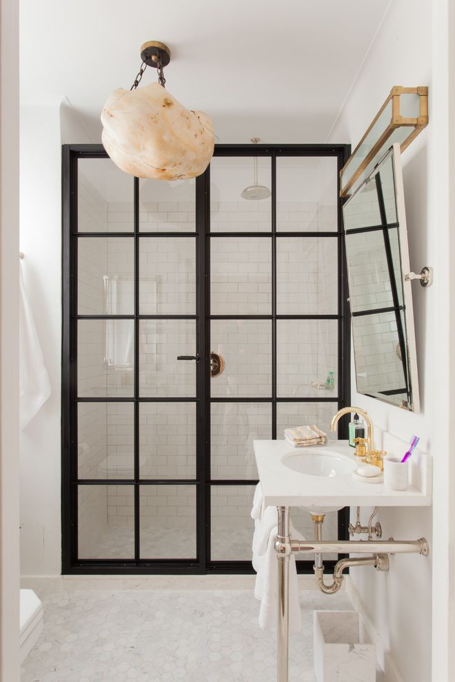 Shower Doors Near Me with Transitional Bathroom Also Black Trim Center Pivot Mirror Glass Doors Hand Painted Cabinets Herringbone Marble Hexagon Floor Tile La Cornue Marble Backsplash Steel Shower Door