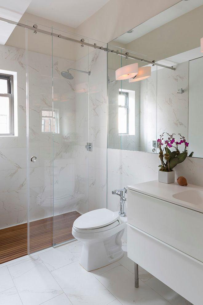 Shower Doors of Austin with Contemporary Bathroom  and Barn Door Shower Barn Shower Door Oversized Bathroom Mirror Sliding Shower Door Wall Sconce White Bathroom White Bathroom Vanity White Floor Wood Shower Floor