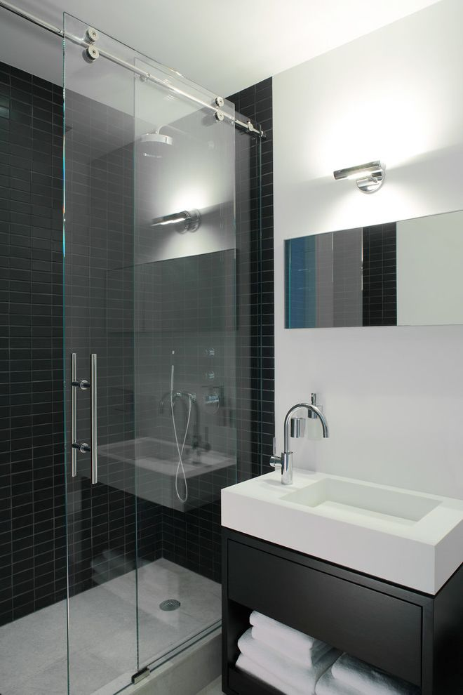 Shower Doors of Austin with Contemporary Bathroom  and Black Shower Tile Black Tile Wall Glass Shower Door One Handle Faucet Sliding Door Sliding Shower Door Vanity Sink Vanity Top Sink Wall Light White Sink