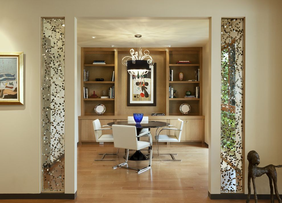 Sidelight Glass Panels with Contemporary Dining Room  and Built in Shelves Chandelier Leather Dining Chairs Metallic Art Modern Icons Neutral Colors Pedestal Table Round Dining Table Santa Barbara
