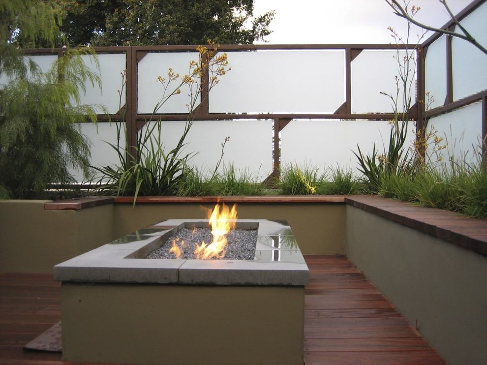 Sidelight Glass Panels with Contemporary Landscape Also Built in Concrete Fencing Fiberoptic Fire Pit Gas Fire Pit Glass Grass Ipe Bench Ipe Deck Paneling Planter Raised Bed Raised Planter Screen Seat Wall Wooden Flooring