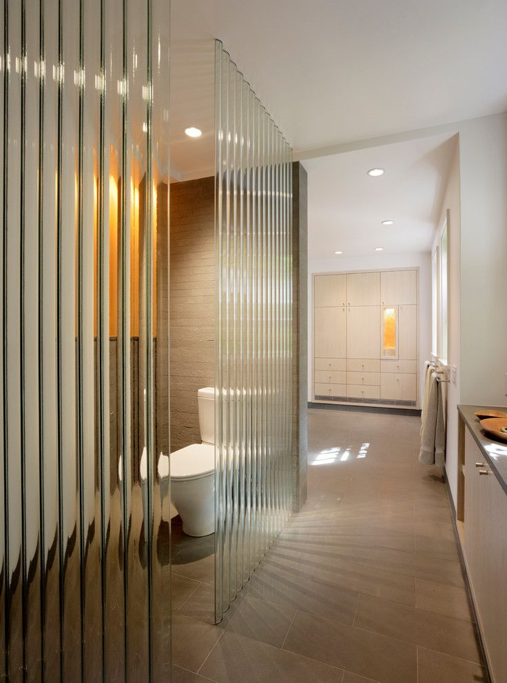 Sidelight Glass Panels with Modern Bathroom Also Bluestone Brick Brown Built in Cabinets Corrugated Glass Glass Wall Narual Wood Neutral Partition Slanted Ceiling Tile Floor Toilet Room White