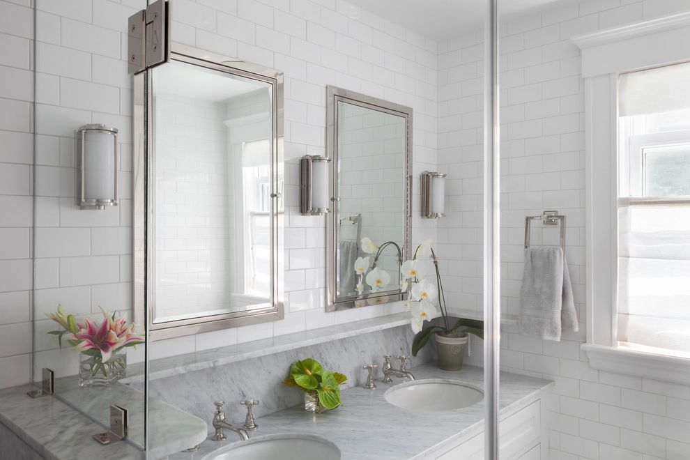 Sigma Faucets   Beach Style Bathroom  and Bathroom Cabinets Double Sink Flower Accents Glass Shower Enclosure Light Bathroom Marble Backsplash Marble Top Master Bathroom Matching Cabinets Two Sinks Wall Sconces White Subway Tile