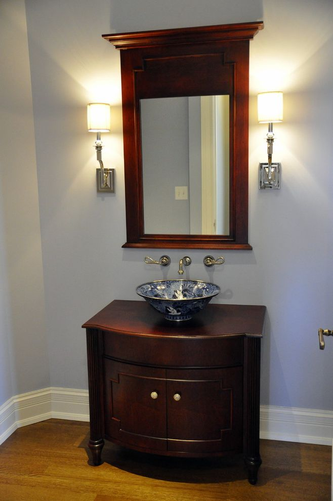 Sigma Faucets   Traditional Bathroom Also Baseboards Bathroom Mirror Dark Wood Cabinets Patterned Sink Sconce Vanity Vessel Sink Wall Lighting Wall Mounted Faucet White Wood Wood Flooring Wood Trim
