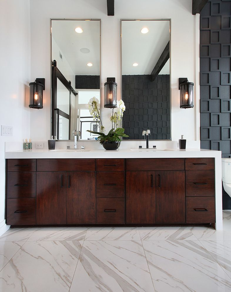 Sigma Faucets   Transitional Bathroom Also Black and White Black Wall Sconce Contemporary Home Flat Panel Cabinets His and Hers Sinks Luxury Mansion Marble Floors Modern Fixtures White Countertops White Orchids