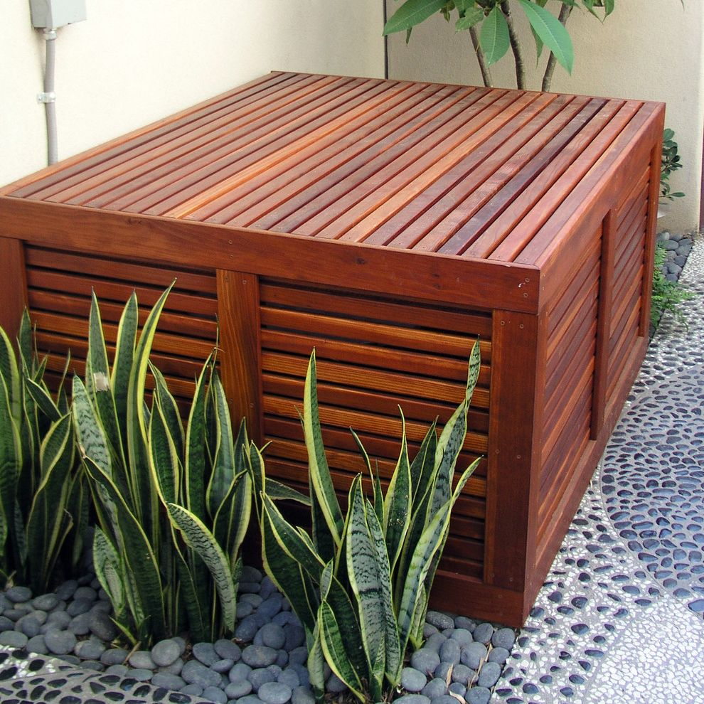 Sila Heating & Air Conditioning   Contemporary Landscape Also Air Conditioner Air Conditioner Cover Camouflage Pebble Patio Wood Slats