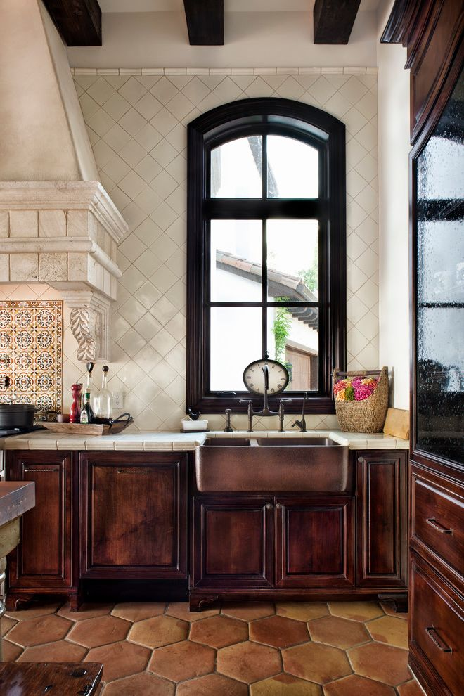 Sink in Spanish   Mediterranean Kitchen Also Apron Sink Arch Window Bar Sink Clock Copper Sink Dark Wood Decorative Hood Exposed Beam Green Island High Ceiling Kitchen Island Spanish Tile Stool Tile Backsplash Tile Floor Wooden Island