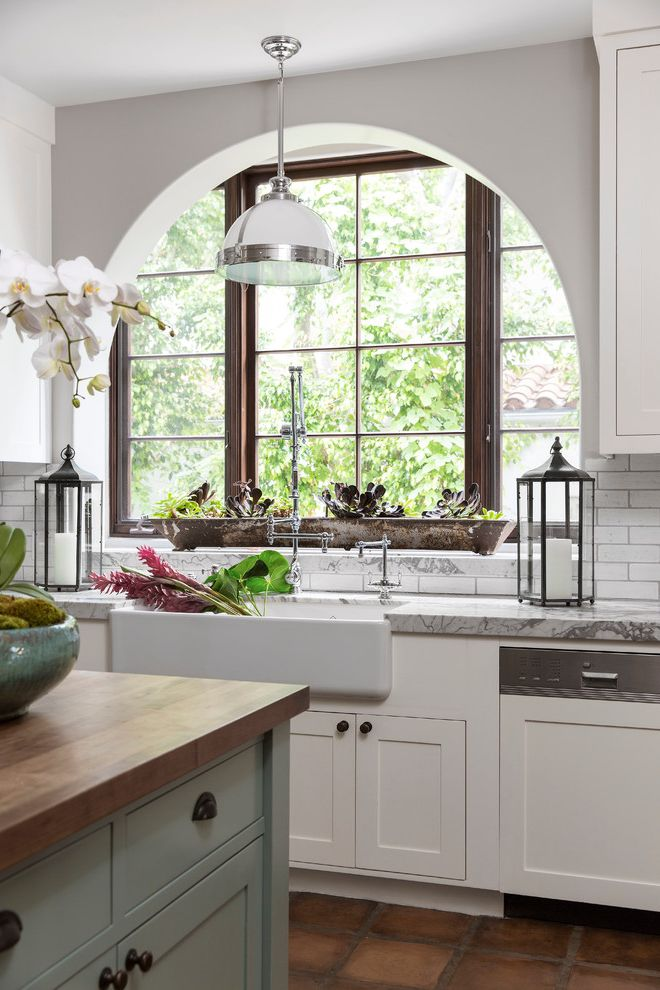 Sink in Spanish with Mediterranean Kitchen Also Arched Window Butcher Island Dark Wood Window Lantern White and Silver Industrial Pendant Light Window Above Sink
