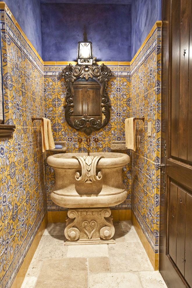 Sink in Spanish with Mediterranean Powder Room Also Accent Tile Bathroom Lighting Bathroom Mirror Blue Walls Floor Tile Floral Tile Guest Bathroom Ornate Painted Tile Stone Floor Stone Sink Wainscoting Yellow Tile