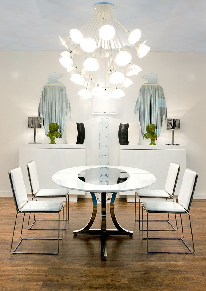 Skinny Side Table with Contemporary Dining Room  and Chandelier Chrome Mirrored Furniture Painted Ceiling Pedestal Table Penguins Round Dining Table Sideboard Table Lamps Tablescape Wall Art Wall Decor White Dining Room White Dining Set Wood Flooring