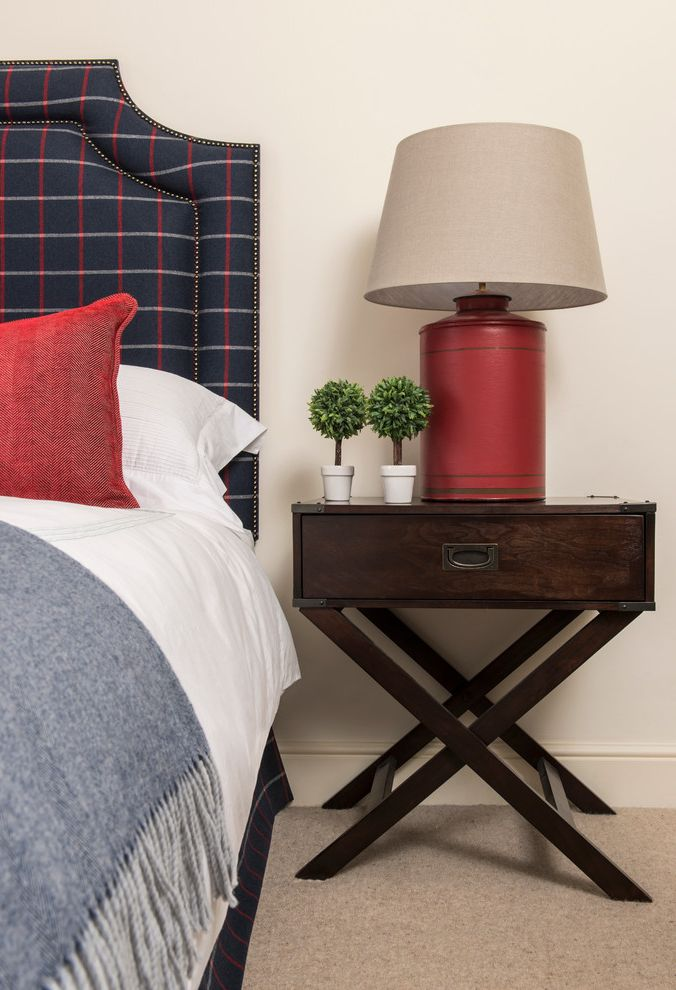 Skinny Side Table with Traditional Bedroom Also Bachelor Bedding Bedroom Bedside Lamps Bedside Tables Boys Bedroom Cushions Flowers Master Bedroom Nailhead Detail Plaid Headboard Red Accents Tartan Throw Tray