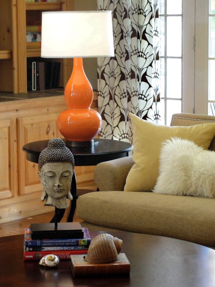Skinny Table Lamps with Eclectic Family Room  and Accent Color Buddha Statue Curtains Decorative Pillows Drapes End Table Side Table Stacked Books Table Lamp Tablescape Throw Pillows Window Treatments Wood Coffee Table