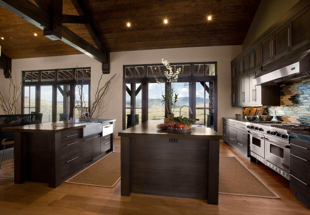 Sky Lodge Park City   Rustic Kitchen  and Accent Tile Barn Branches Dark Wood Trim Hight Ceiling Kitchen Island with Sink Light Wall Porcelain Sink Stainless Steel Range Wood Beams Wood Cabinets Wood Ceiling Wood Trim
