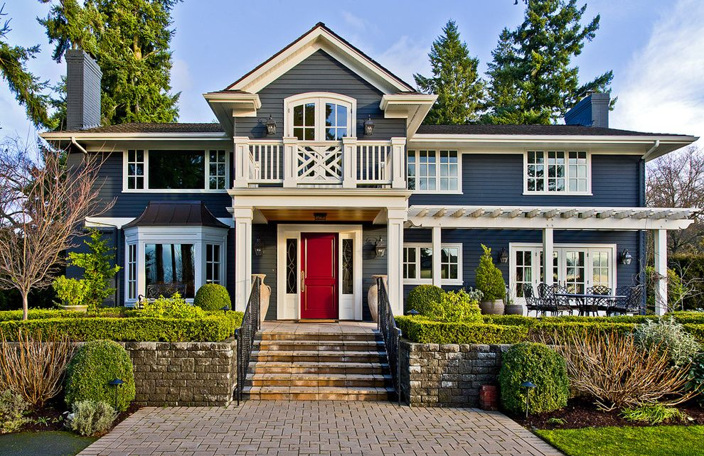 Slate Blue Vinyl Siding   Traditional Exterior  and Balcony Bay Window Brick Paving Chippendale Railing Covered Patio Entrance Entry Front Door Hedge Lap Siding Metal Roof Pergola Sidelights Stone Wall White Trim Wood Siding