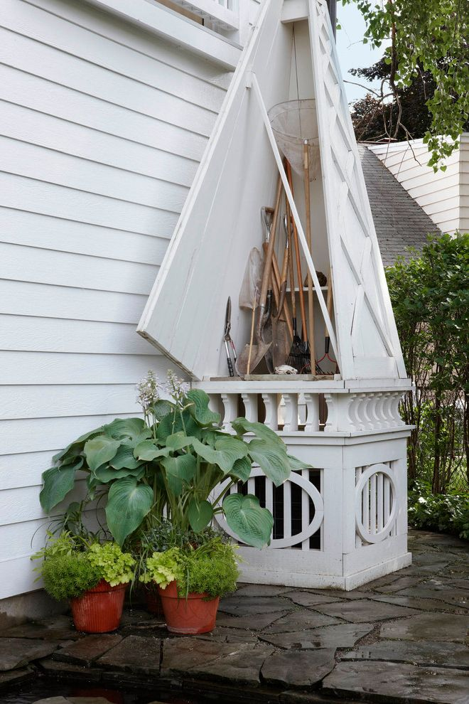 Slider Window Air Conditioner with Traditional Shed Also Clapboard Flagstone Lap Siding Lattice Potted Plants Tool Shed Triangle Door White Painted Wood